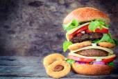 Beef burger and onion rings — Stock Photo