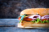 Italian sandwich on wooden background — Stok fotoğraf