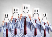 Businessmen holding paper with happy and negative symbols — Foto Stock