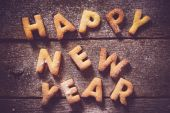 Happy New Year text with cookies — Stock Photo