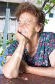 Old female with smile on her face — Photo