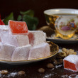 Traditional turkish delight with rose — Stock Photo #54499815