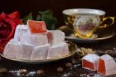 Traditional turkish delight with rose — Stock Photo