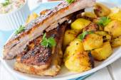 Beef ribs and baked potatoes — Stock Photo
