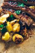 Baked potato and beef ribs — Stock Photo