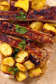 Beef ribs and baked potatoes from above — Stock Photo