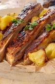 Sliced ribs and potatoes — Stock Photo