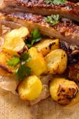 Pub food, beef ribs and baked potatoes — Stock Photo