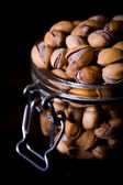 Large group of pistachios in jar — Stock Photo