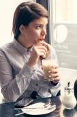 Female making coffee break in cafe — Stock Photo