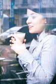 Woman with a cup of coffee — Stock Photo