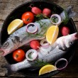 Bass fish in the old pan — Stock Photo #58231319