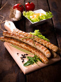 Juicy grilled traditional German wurst — Stock Photo