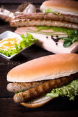 Grilled sausages in bun — Stock Photo