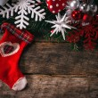 Christmas decoration on old wooden background — Stock Photo #58908897