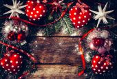 Christmas decoration on old wooden board — Stock Photo
