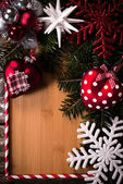 Board in the middle of Christmas decoration — Stok fotoğraf