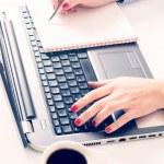 Woman typing on laptop keyboard — Stock Photo #59545059