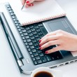 Woman typing and writing at the office — Stock Photo #59547859