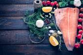 Raw salmon and large group of ingredients — Stock Photo