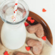 Bottle of milk and heart shape cookies — Stock Photo #62795951