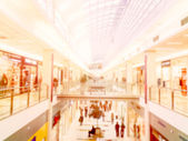 Blurred stores in the shopping mall — Stock Photo