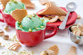 Ice cream with pistachio flavour in the cup — Stock Photo
