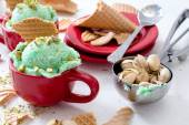 Pistachios ice cream in the cup — Stock Photo