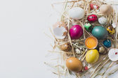 Splashed Easter eggs in the nest — Stock Photo