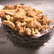 Stuffed with fried chicken and French fries — Stock Photo #67202685