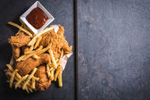 Fried chicken meat and French fries — Stock Photo