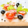 Sliced cherry tomatoes and black olive — Stock Photo #67766511