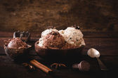 Sweet ice cream in wooden bowl — Stock Photo