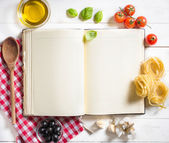 Blank recipe cooking book and ingredients — Stock Photo
