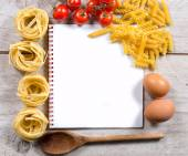 Cook book with set up for preparing Italian cuisine — Stock Photo