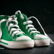 Green and urban style sneakers — Stock Photo #68787975