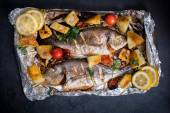 Gilthead fish and ingredients — Stock Photo