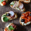 Tasty bruschettas — Stock Photo #70681121