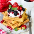 Постер, плакат: Waffles and berry fruits
