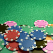 Casino chips show hand green table — Stock Photo #71340287
