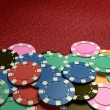 Casino chips show hand red table — Stock Photo #71340297