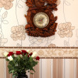 Vase of roses clock on the wall — Stock Photo #54440527