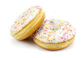 Delicious sweet donuts on white background. — Stock Photo