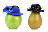 Apple and pear in a hat — Stock Photo