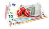 Red dices and money — Stock Photo