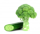 Cucumber and broccoli on a white background — Stock Photo