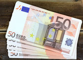Euro  on a wooden table — Stock Photo