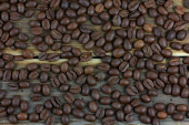Fresh coffee beans on wood background. — Stock Photo