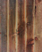 Rustic weathered barn wood background with knots and nail holes. — Stock Photo