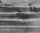 Rustic weathered barn wood background with knots and nail holes — Stock Photo